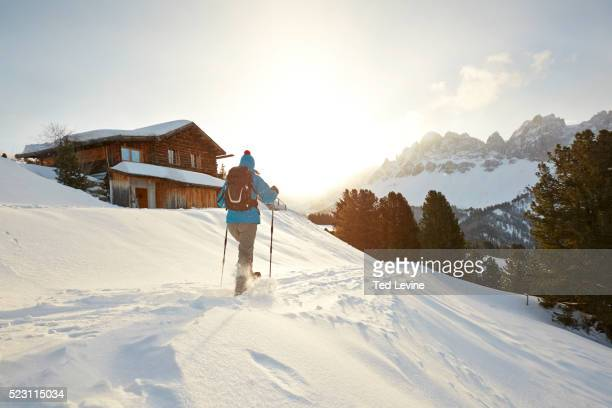 Woman snowshoeing in Dolomites, Schatzer Hut, Eisacktal, South Tyrol, Italy