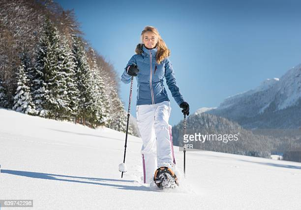 Woman Snowshoeing through a Winter Wonderland, Austrian Alps