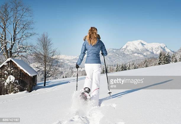 Woman Snowshoeing through a Winter Wonderland, Fresh Powder Snow
