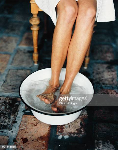 woman soaking feet in basin - wash bowl stock pictures, royalty-free photos & images