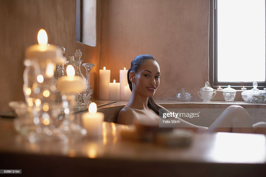 Woman soaking in bathtub : Stock Photo