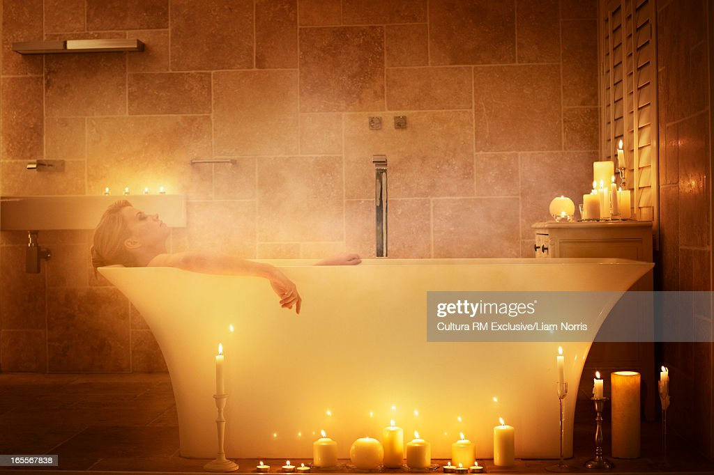 Woman Soaking In Bathtub With Candles Stock Photo | Getty Images