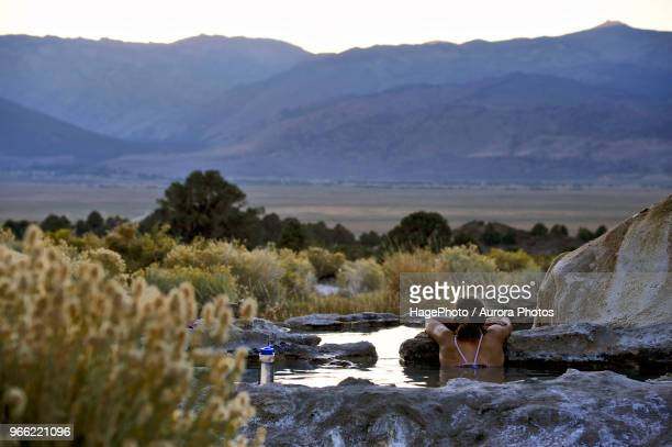 woman soaking in hot spring - hot spring stock pictures, royalty-free photos & images