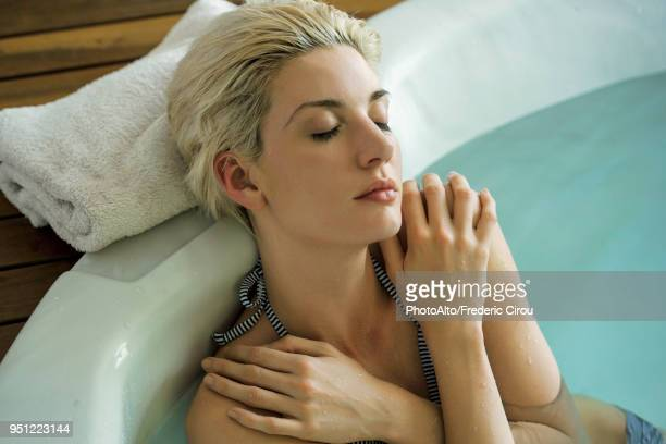 woman soaking in tub - hydrotherapy stock photos and pictures