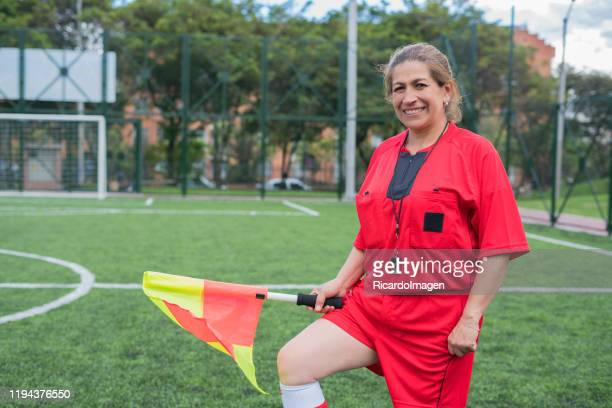 woman soccer referee looks at the camera while starting the match - female umpire stock pictures, royalty-free photos & images