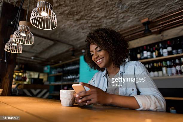 Woman social networking at a cafe