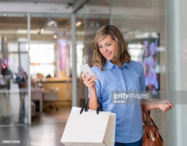 Woman social networking at a shopping center