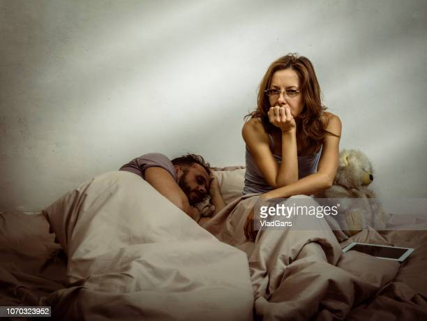 Woman social networking in bed