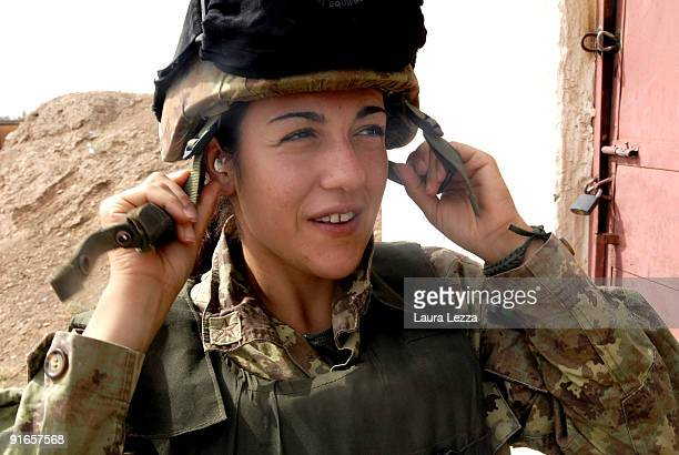 A woman soldier of the Folgore Parachute Brigade prepares before an excercise in the military shooting centre on September 17 2009 in Shindand...