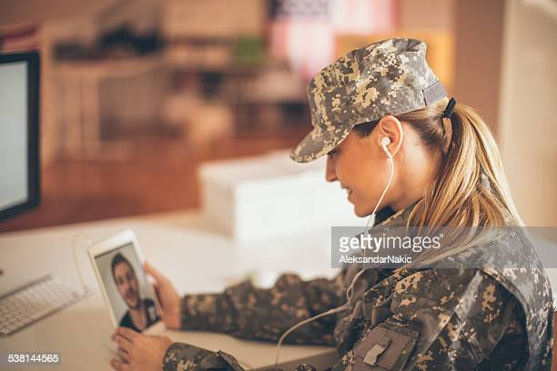 Woman soldier talking to her family