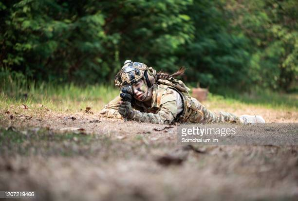 a woman soldier with gun - armed forces day stock pictures, royalty-free photos & images