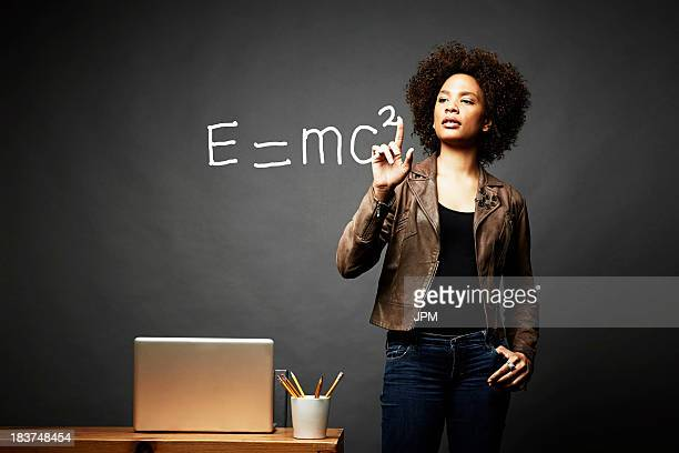 Woman solving mathematical equation