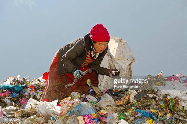 VALLEY ALETAR KATHMANDU NEPAL A woman sorting out garbage at Aletar garbage dump The garbage collected off the streets of the capital city is mostly...