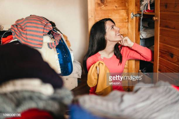 woman sorting out wardrobe - neat stock pictures, royalty-free photos & images