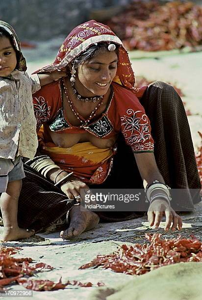 Woman sorting red chillies Kishangarh Fort Kishangarh Rajasthan India
