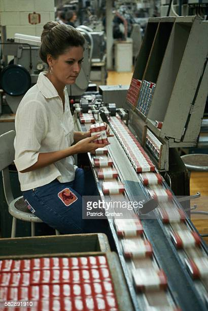A woman sorts Winston cigarettes at RJ Reynolds Tobacco Company