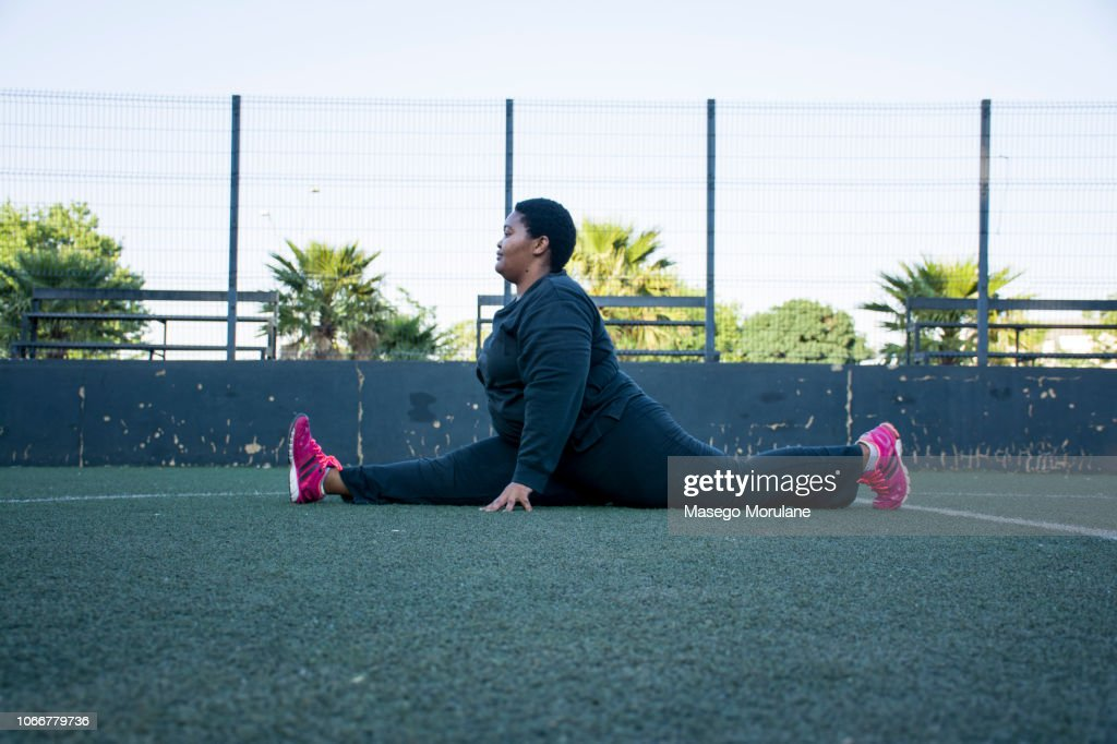 Woman stretching after a morning jog : Stock Photo