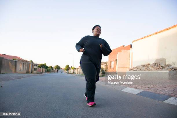 woman jogging - soweto stock pictures, royalty-free photos & images