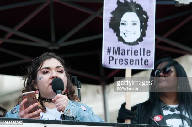 A woman speaker from the Brazilian Women Against Fascism UK group seen speaking during the protest Huge crowds marched from the BBC in Portland Place...