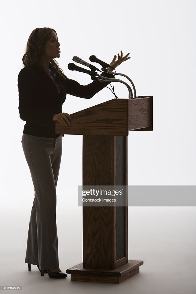 Woman speaking from podium : Stock Photo