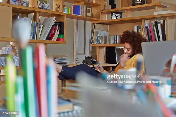 Woman speaking on telephone in office