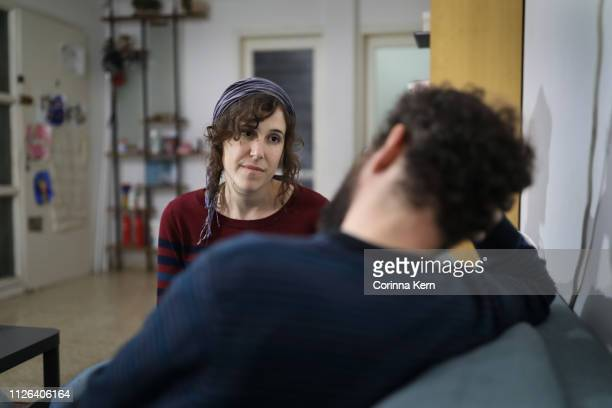 woman speaking with partner at home - judaism stock pictures, royalty-free photos & images