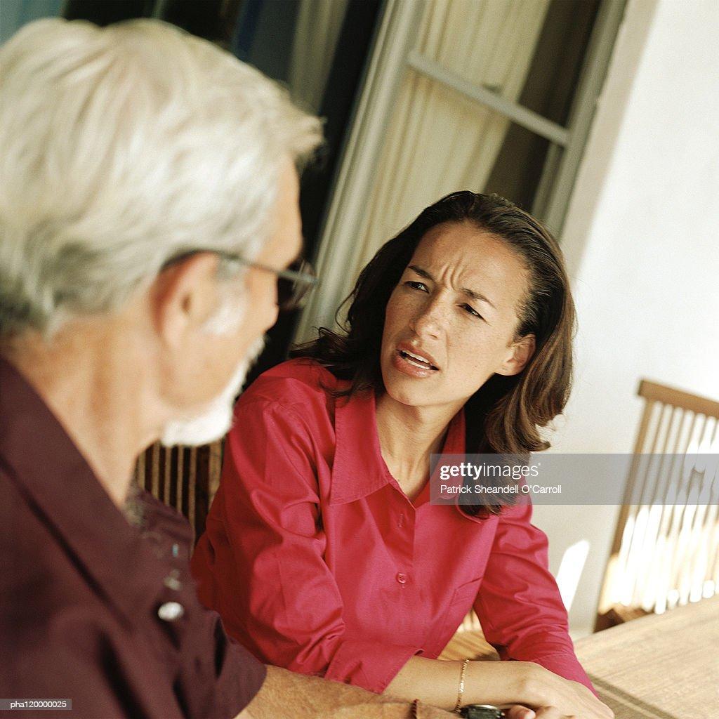 Woman speaking with senior man : Stockfoto