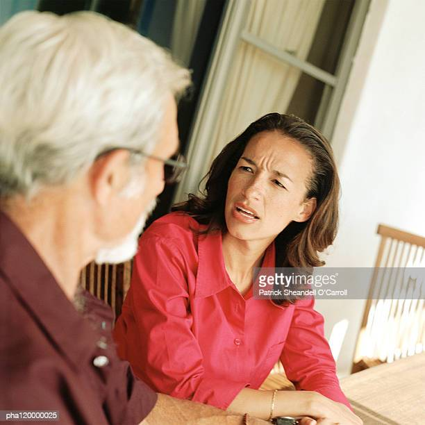 woman speaking with senior man - adults only stock pictures, royalty-free photos & images