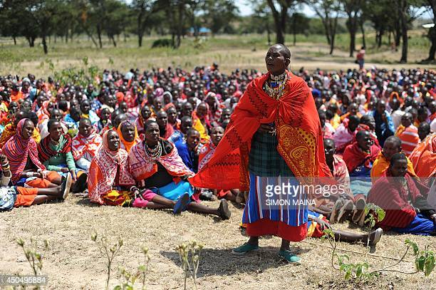 A woman speaks as Kenyan Maasai women gather for a meeting dedicated to the practice of female genital mutilation in which several participants...