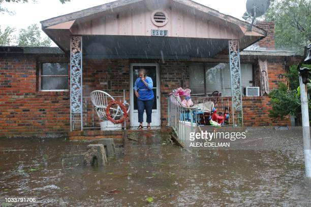 TOPSHOT A woman speaks into a cellphone asking for help at her flooded residence in Lumberton North Carolina on September 15 2018 in the wake of...