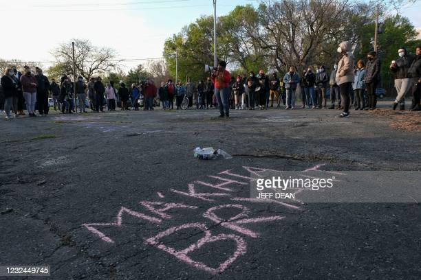 Woman speaks on a megaphone as people gather for a vigil in Columbus, Ohio on April 21, 2021 to remember MaKhia Bryant who was shot and killed by a...