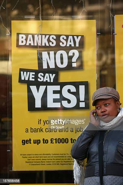 A woman speaks on a mobile phone outside a moneylending shop on Lewisham high street on December 5 2012 in London England The Chancellor of the...