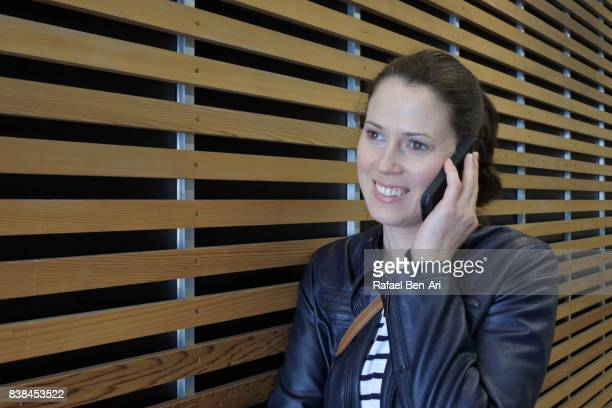 Woman speaks on a mobile phone
