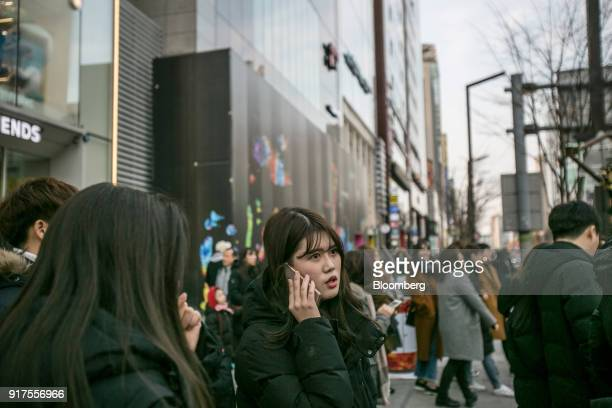 A woman speaks on a smartphone in Seoul South Korea on Sunday Jan 28 2018 5G the fifthgeneration wireless network is making its worldwide debut at...