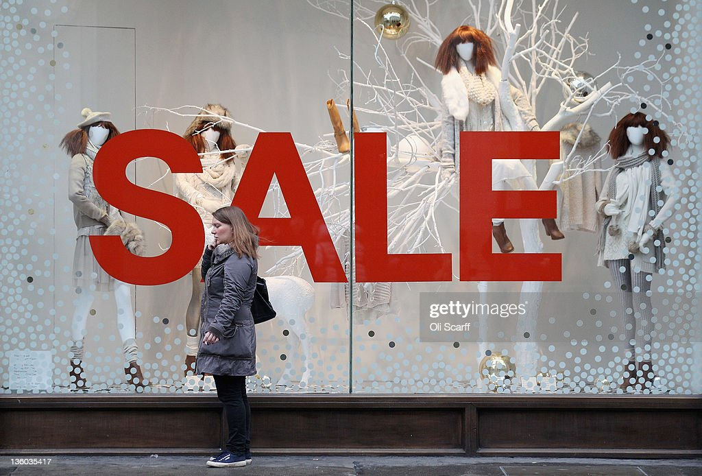 A woman speaks on her mobile phone outside a shop on Oxford Street on the penultimate Saturday before Christmas Day on December 17, 2011 in London, England. Retail analysts have predicted that today will be the busiest day of the year for high street gift purchases with spending set to exceed 1 billion GBP.
