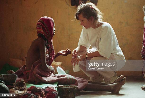 A woman speaks to a malnourished Somalian adolescent at a hospital in Baidoa The hospital which has no running water or electricity and almost no...