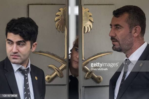 A woman speaks to security personel at the front door of Saudi Arabia's consulate on October 11 2018 in Istanbul Turkey Fears are growing over the...