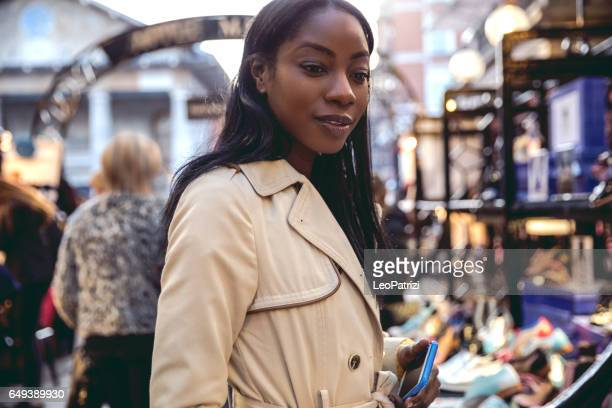 Woman spending a weekend in Central London buying at outdoor markets