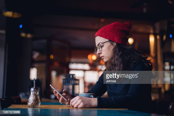 woman spending relaxing time at cafe - central europe stock photos and pictures