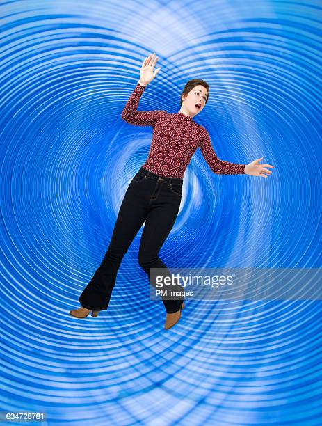 woman spinning in blue vortex - down blouse stock pictures, royalty-free photos & images