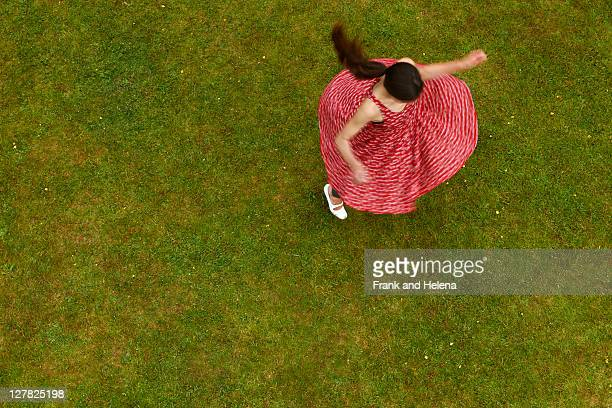 woman spinning outdoors - kleid stock-fotos und bilder