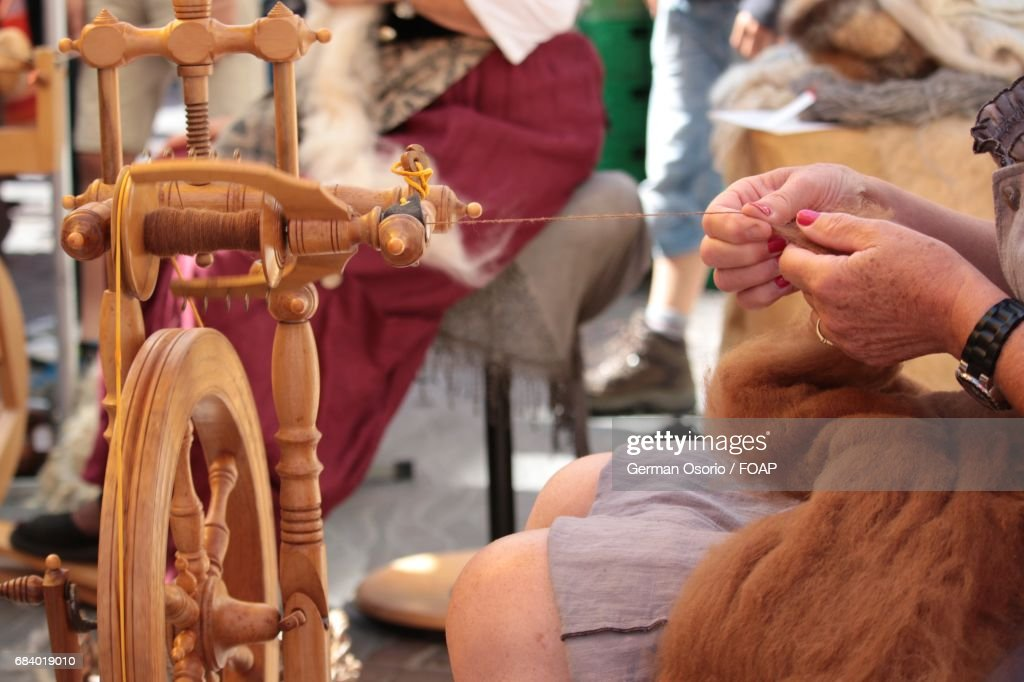 Woman spinning wheel to make yarn : Stock Photo