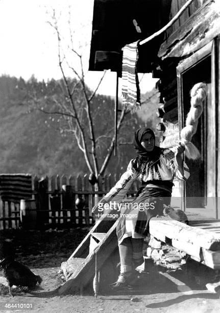 Woman spinning wool Bistrita Valley Moldavia northeast Romania c1920c1945 Depicting customs and traditional labour in the rural Carpathian Mountains...