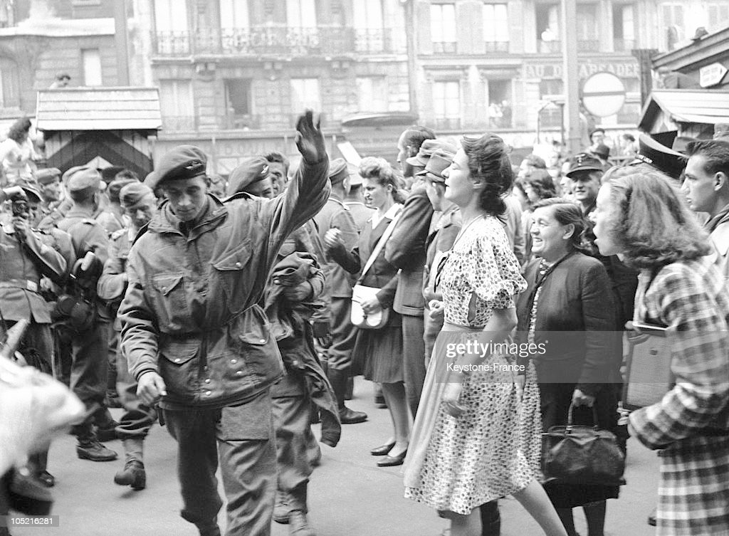 A Parisian Woman Spitting In The Face Of An American Prisoner In Paris In 1944 : News Photo