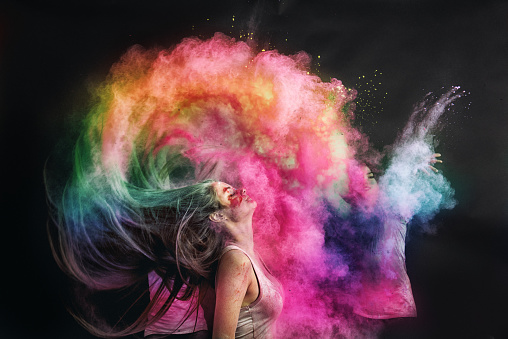 Woman splashing hair with holi powder - gettyimageskorea