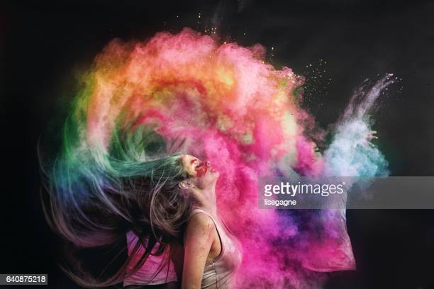 woman splashing hair with holi powder - images foto e immagini stock