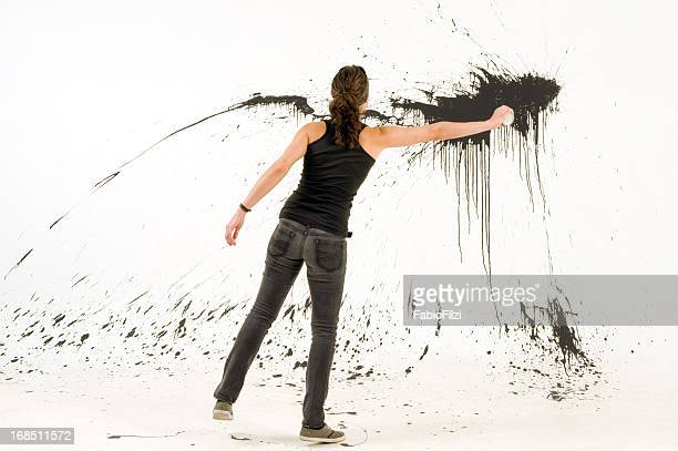 woman splashing the wall - artist stock pictures, royalty-free photos & images