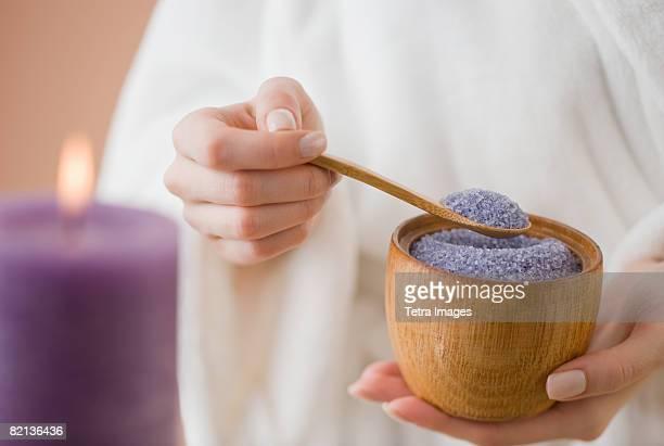 Woman spooning bath salts