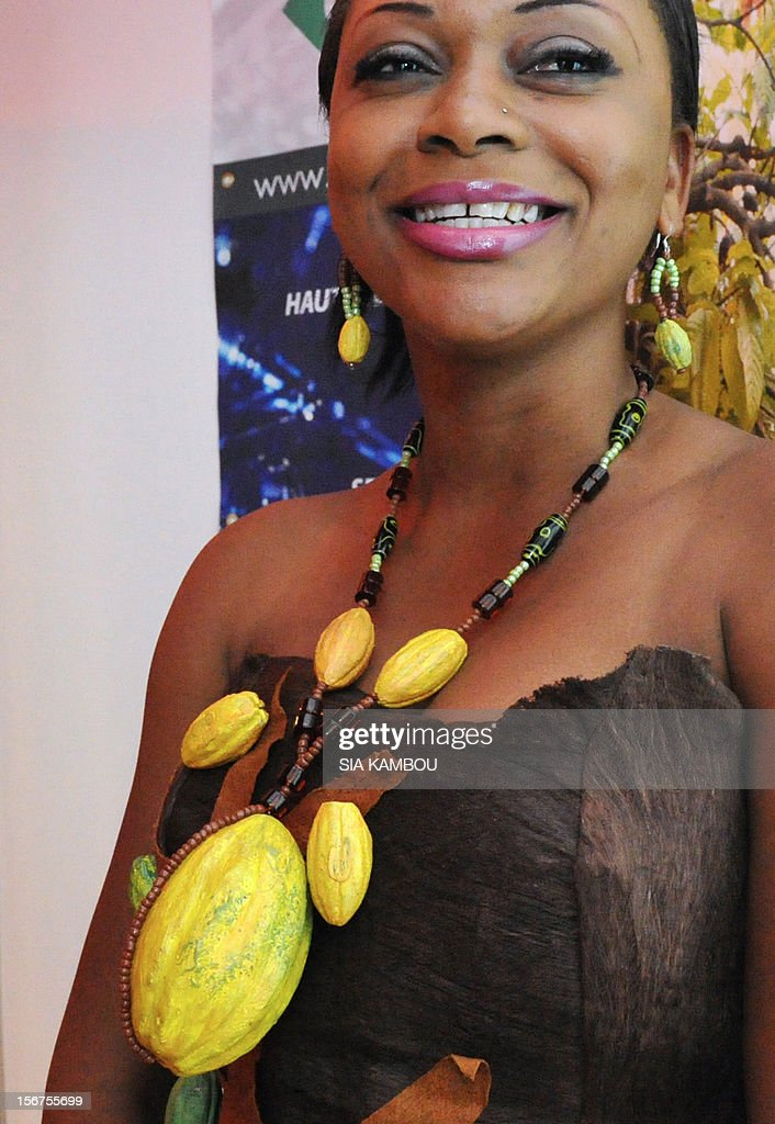 A woman sports a collar made of cocoa pods, on November 20, 2012, in Abidjan, prior to the opening of the first World Cocoa Conference