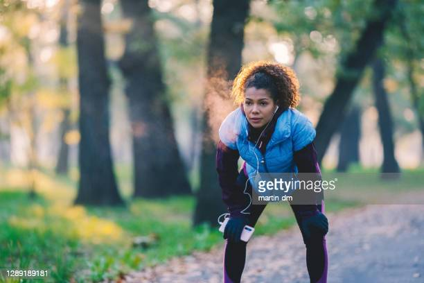 woman sports training in the park - cold temperature stock pictures, royalty-free photos & images